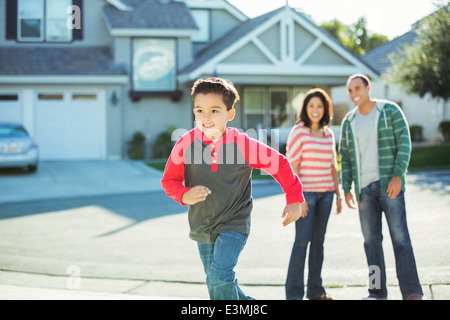 Boy running outdoors - Stock Photo