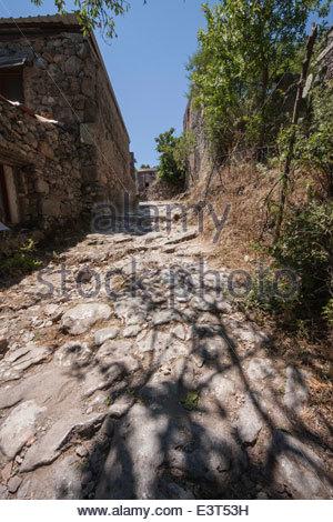 Shady street in Kayakoy, abandoned Greek village near Hisaronu, Turkey - Stock Photo