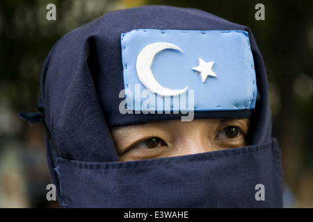 A veiled supporter of the Turkistan Islamic Movement (TIM) formerly known as the East Turkestan Islamic Movement - Stock Photo