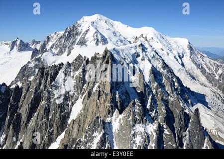 AIGUILLES DE CHAMONIX, AIGUILLE DU MIDI & MONT-BLANC (aerial view). Chamonix Mont-Blanc, Haute-Savoie, France. - Stock Photo