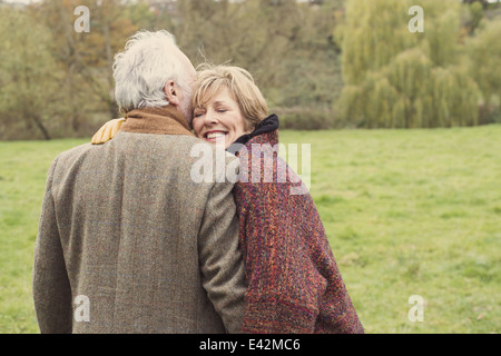 Couple hugging, portrait - Stock Photo