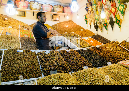 A nut and dried fruit stall in the Souks, Marrakech, Morocco - Stock Photo