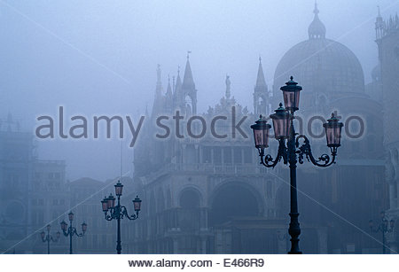 Doges Palace and Venetian lamps in mist. St Mark's Square, Venice, Italy. The Doge's palace is the biggest civic - Stock Photo