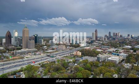Elevated view over Interstate 85 passing the Atlanta skyline, Atlanta, Georgia, United States of America - Stock Photo