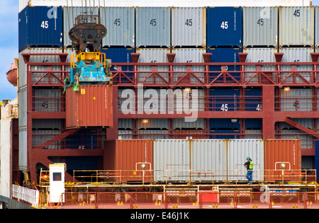 Cargo container being lowered onto container ship by crane, Port of Tacoma, Washington USA - Stock Photo
