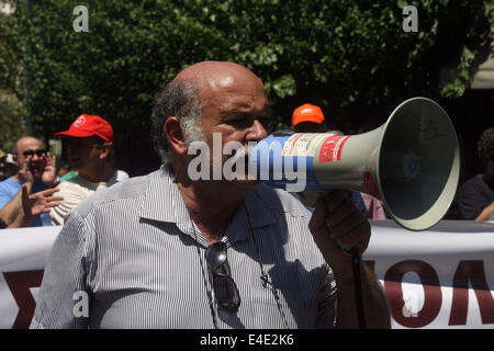Athens, Greece. 9th July, 2014. A protester chants slogans during a protest by public sector workers marking the - Stock Photo