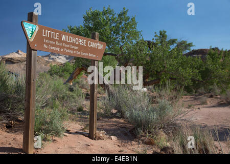 Hanksville, Utah - Sign warns of flash flood danger at entrance to Little Wild Horse Canyon. - Stock Photo