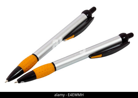 two orange, silver and black ballpoint pens on white - Stock Photo