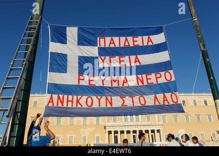 Athens, Greece. 9th July, 2014. Public Power Corporation workers protest outside the Greek parliament against government - Stock Photo