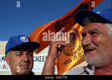Athens, Greece. 9th July, 2014. PPC workers gather during a protest against the company's privatization outside - Stock Photo