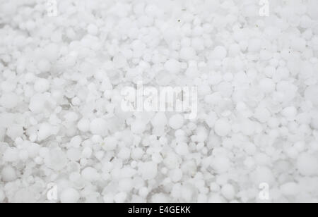 Settled hailstones after a sudden heavy storm. - Stock Photo