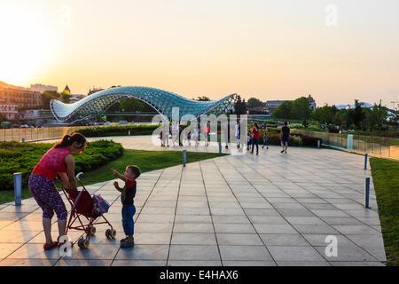 Peace Bridge and Rike Park at sunset, Tbilisi, Georgia - Stock Photo