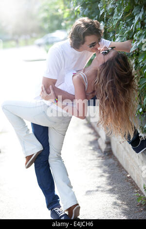 Lovely couple having great quality time in the city streets. - Stock Photo
