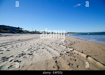 Cronulla Beach in Sydney's south during the month of July (Sydney's winter). Looking towards the Kurnell Peninsula. - Stock Photo