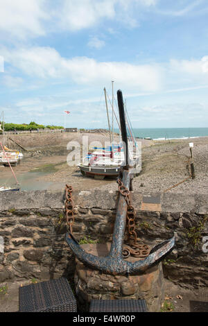 Old ships anchor on harbour wall - Stock Photo