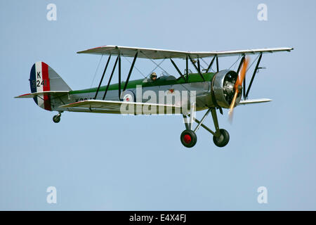 England UK circa 2014 An unamed pilot flies the Avro Tutor K3241 Bi Plane at a vintage air pageant to a watching - Stock Photo
