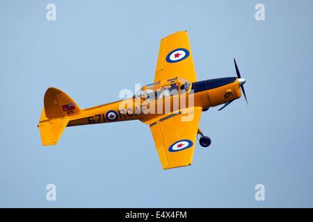 England UK circa 2014 An unamed pilot flies the De Havilland Canada DHC-1 Chipmunk 22  at a vintage air pageant - Stock Photo