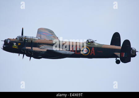 England UK circa 2014 An unamed pilot flies the Avro Lancaster PA 474 Bomber at a vintage air pageant - Stock Photo