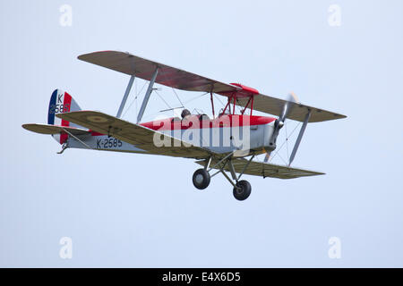 England UK circa 2014 An unamed pilot flies the DH82A Tiger Moth II K2585 G-ANKT BiPlane at a vintage air pageant - Stock Photo