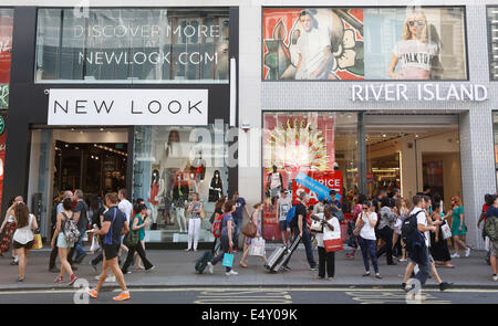 UK, London : New Look and River Island are pictured on Oxford Street in Central London on 17 July 2014. - Stock Photo