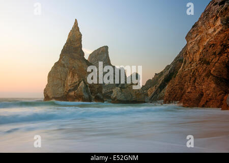 Ursa Beach on the Atlantic coastline has dramatic rock formations called the Giant and the Bear. - Stock Photo