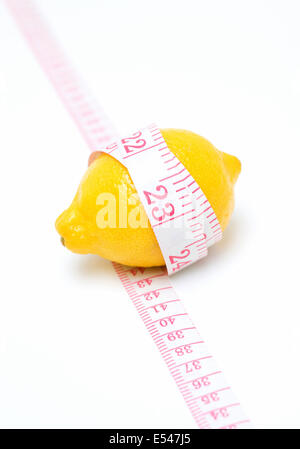 Lemon and Tape measure isolated on white background - Stock Photo