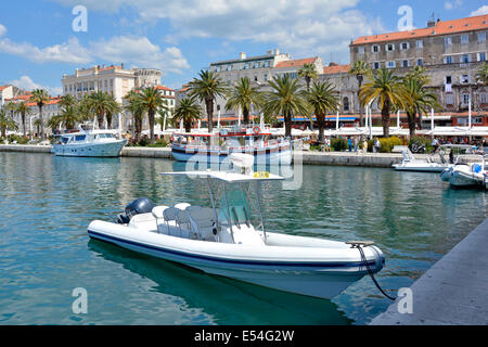 Water Taxi and other boats moored in the harbour at Split in Croatia - Stock Photo