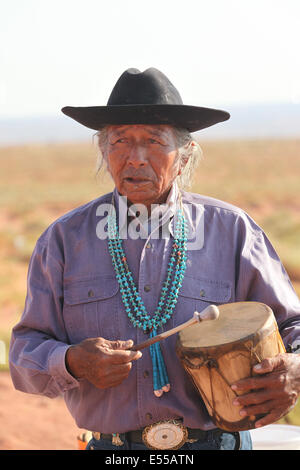 Native american man, Navajo indian, in Monument Valley, USA, with drums and necklace - Stock Photo