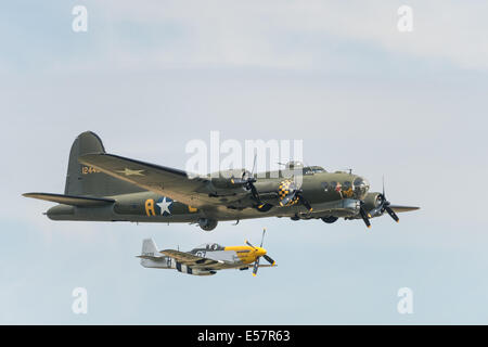 Sally B flying fortress flying with a P51D mustang - Stock Photo