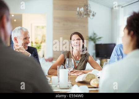 People talking at dinner party - Stock Photo