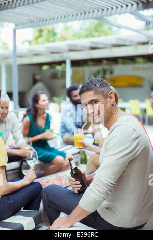 Man smiling at party - Stock Photo