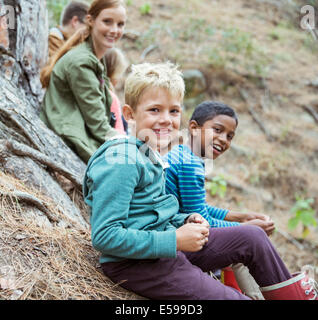 Students and teachers smiling in forest - Stock Photo