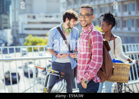 Man smiling on city street - Stock Photo