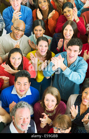 Portrait of happy crowd clapping - Stock Photo