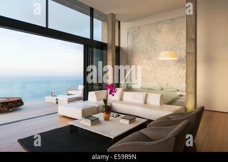 Modern living room overlooking ocean - Stock Photo