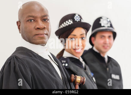 Portrait of confident judge and police - Stock Photo