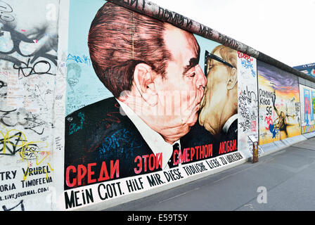 Germany, Berlin: Famous  'Brother kiss' at the former wall and actural East Side Gallery - Stock Photo