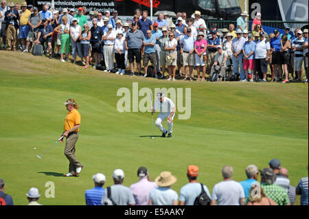 Porthcawl, Wales, UK. 25th July, 2014. Leader Bernhard Langer lines up his shot on the 13th green  during day two - Stock Photo
