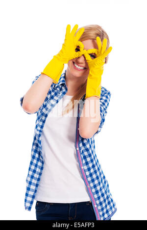 Cheerful woman with protective glove making hand gesture, Debica, Poland - Stock Photo