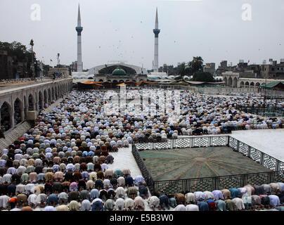 Pakistani faithful Muslims offer Jummat-ul-Vida, the last congregational Friday prayers in the holy month of Ramadan, - Stock Photo