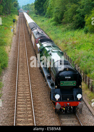 Reigate, Surrey, UK. 26th July, 2014.  The Belmond British Pullman VS Orient Express Steam Locomotive BR(S) Merchant - Stock Photo