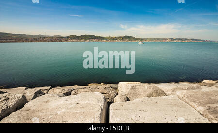 boat sailing from the docks in a hot summer morning - Stock Photo