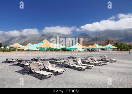 Beach with sun beds, the Venetian castle at the back, Frangokastello, Crete, Greece - Stock Photo