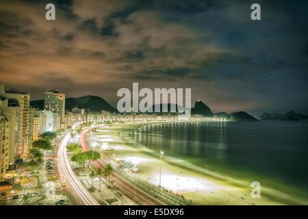 Night time view of Copacabana beach in Rio de Janeiro - Stock Photo