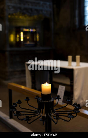 A lit candle in All Hallows by the Tower church, also previously dedicated to St. Mary the Virgin - Stock Photo