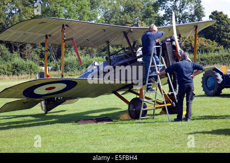 England UK circa 2014 Unamed engineers prepare a vintage BiPlane at a vintage air pageant - Stock Photo