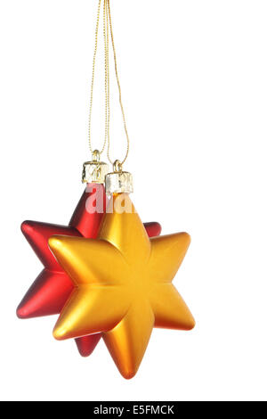 Gold and red Christmas stars isolated over a white background - Stock Photo