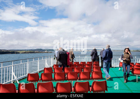 Passengers on Caledonian MacBrayne Calmac ferry upper deck sailing to Ullapool from Stornoway Isle of Lewis Outer - Stock Photo