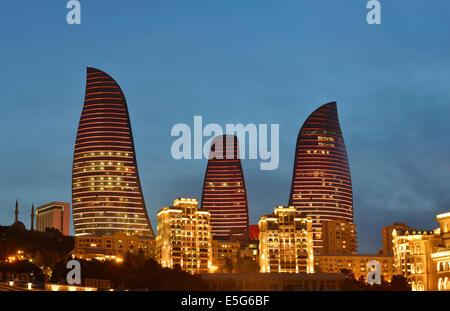 Flame Towers at dusk, Baku, Azerbaijan - Stock Photo