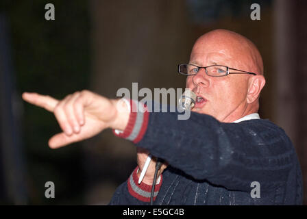 Auctioneer at work taking bids for goods at a fundraising event for local charities, Churt, near Farnham, Surrey, - Stock Photo
